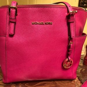 Authentic hot pink Michael kors purse with wallet.